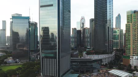 sudirman : JAKARTA, Indonesia - January 02, 2019: Drone view of skyscrapers exterior with glass windows in Jakarta business district. Shot in 4k resolution Stock Footage