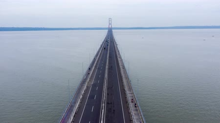 körképszerű : Aerial hyperlapse of fast traffic on the Suramadu Bridge with Suramadu Strait view from Surabaya City to Madura Island at East Java, Indonesia. Shot in 4k resolution
