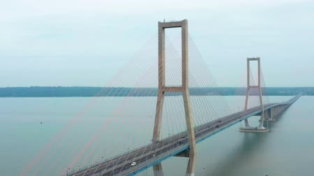 madura : Beautiful aerial landscape of the tower of Suramadu Bridge at Surabaya City to Madura Island, East Java, Indonesia. Shot in 4k resolution Stock Footage