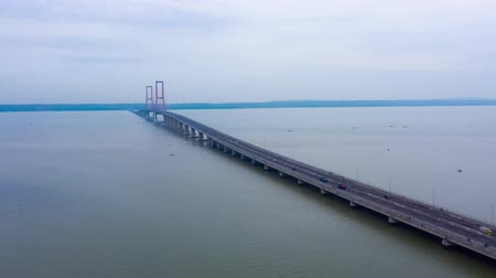 madura : Beautiful aerial hyperlapse of Suramadu Bridge on the Madura Strait from Surabaya City to Madura Island, East Java, Indonesia. Shot in 4k resolution
