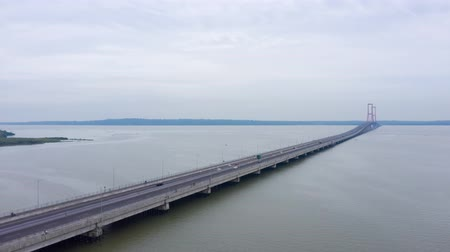 madura : Aerial hyperlapse of Madura Strait and Suramadu Bridge from Surabaya City to Madura Island at East Java, Indonesia. Shot in 4k resolution Stock Footage