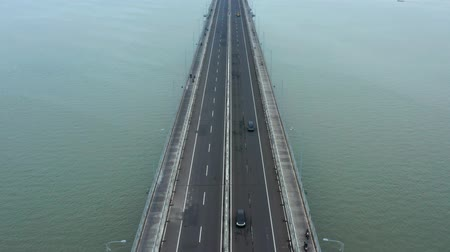 madura : Aerial landscape of fast traffic on Suramadu Bridge at Madura strait from Surabaya City to Madura Island, East Java, Indonesia. Shot in 4k resolution Stock Footage