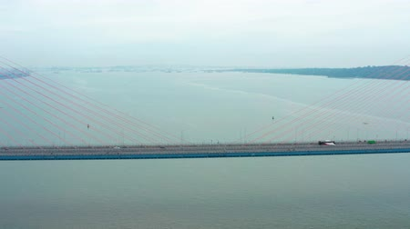 madura : Aerial landscape of Suramadu Bridge with fast traffic at Surabaya City to Madura Island, East Java, Indonesia. Shot in 4k resolution