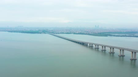 madura : Beautiful aerial scenery of Suramadu Bridge on the Madura Strait from Surabaya City to Madura Island, East Java, Indonesia. Shot in 4k resolution