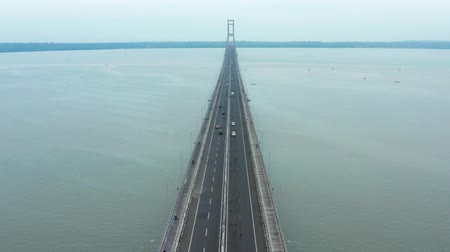 madura : Beautiful aerial view of Suramadu Bridge with Madura strait background from Surabaya City to Madura Island, East Java, Indonesia. Shot in 4k resolution