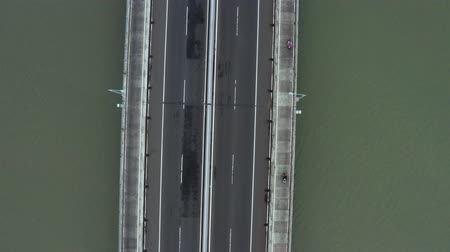madura : Top down view of traffic on the Suramadu Bridge from Surabaya City to Madura Island, East Java, Indonesia. Shot in 4k resolution