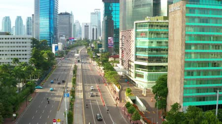 sudirman : JAKARTA, Indonesia - January 22, 2019: Aerial view of queit traffic on Sudirman street with skyscrapers and Hotel Indonesia Roundabout in Jakarta, Indonesia. Shot in 4k resolution