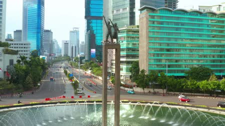 sudirman : JAKARTA, Indonesia - January 22, 2019: Aerial view of Selamat Datang Monument with fountain in Hotel Indonesia Roundabout at Jakarta, Indonesia. Shot in 4k resolution