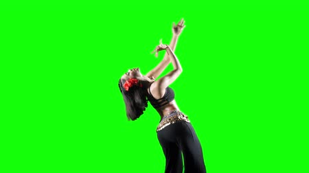 aerobic : Pretty woman exercising zumba dance while wearing sportswear in the studio. Shot in 4k resolution with green screen background