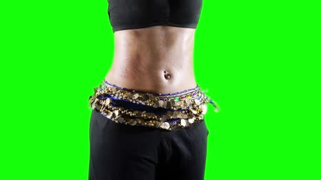 unidentified : Slow motion of woman belly exercising a zumba dance in the studio with green screen background