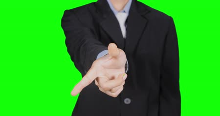 unidentified : Businessman hand touching virtual screen in the studio. Shot in 4k resolution with green screen background