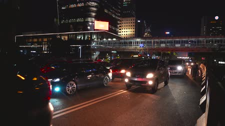 sudirman : JAKARTA, Indonesia - February 11, 2019: Crowded cars on traffic jam at night in Sudirman street, Jakarta city, Indonesia. Shot in 4k resolution Stock Footage