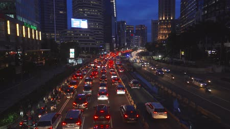 sudirman : JAKARTA, Indonesia - February 11, 2019: Traffic jam at night on Sudirman street in Jakarta downtown, Indonesia. Shot in 4k resolution Stock Footage