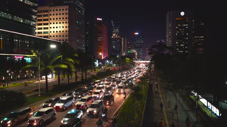 sudirman : JAKARTA, Indonesia - February 11, 2019: Night traffic jam with crowded vehicles on Sudirman street in Jakarta city, Indonesia. Shot in 4k resolution Stock Footage