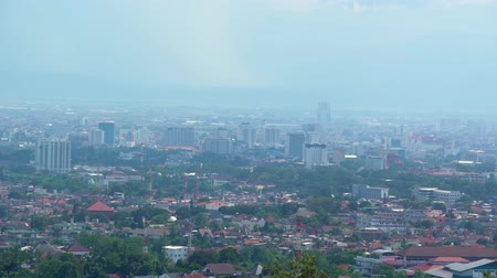 západ : Beautiful aerial view of Bandung cityscape on misty morning, West Java, Indonesia. Shot in 4k resolution