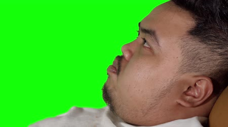 voracious : Closeup of fat man eating french fries in the studio. Shot in 4k resolution with green screen background