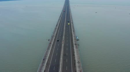 madura : Aerial view of fast traffic on Suramadu Bridge at Suramadu Strait from Surabaya to Madura, East Java, Indonesia. Shot in 4k resolution Stock Footage