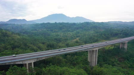 trans : Beautiful aerial view of Trans-Java Toll Road bridge and tropical forest in Bawen, Central Java, Indonesia. Shot in 4k resolution