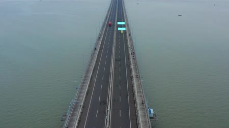 mph : Aerial view of vehicles moving on Suramadu Bridge with speed information sign. Shot in 4k resolution