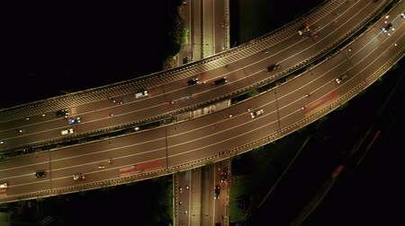 passagem elevada : Aerial view of night traffic on highway bridge in Jakarta downtown, Indonesia. Shot in 4k resolution