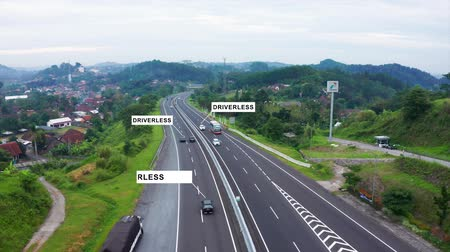 auta : Ungaran, Central Java, Indonesia - February 28, 2019: Aerial view of driverless car moving on toll road.