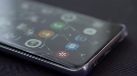 odemknout : JAKARTA, Indonesia - March 14, 2019: Male finger unlock Samsung Galaxy S10 smartphone with fingerprint scanner. Shot in 4k resolution