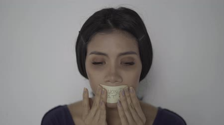 anorexia : Young skinny anorexic woman covering her mouth with text of I Wont Eat. Shot in 4k resolution Stock Footage