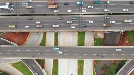 forwards : Top down view of traffic on Depok Antasari interchange and Jakarta Outer Ring Road Toll from a drone flying forwards. Shot in 4k resolution