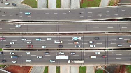 central business district : Top down view of rush hours traffic on Jakarta Outer Ring Road Toll around Depok Antasari intersection from a drone. Shot in 4k resolution Stock Footage