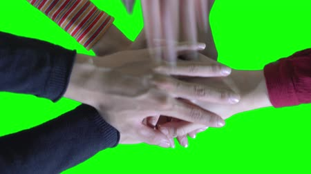 szakszervezet : Close up of group of young people putting their hands together. People with stack of hands showing unity, teamwork, togetherness, and collaboration. Shot in 4k resolution