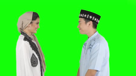 saudação : Young muslim couple giving a greeting hands gesture to each other and talking together in the studio Vídeos