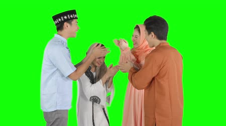 saudação : Group of young muslim community with greeting hands gesture for forgiving each other in the studio. Shot in 4k resolution with green screen background