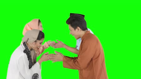 saudação : Group of attractive young muslim people forgiving each other by showing a greeting hands gesture in the studio. Shot in 4k resolution with green screen background