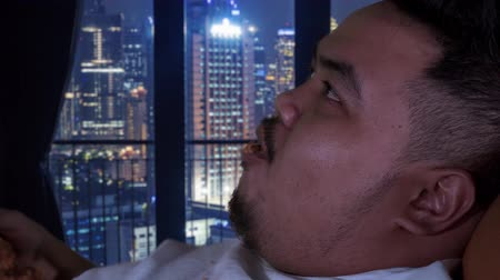voracious : Closeup of obese man eating fried chicken in apartment. Shot in 4k resolution Stock Footage