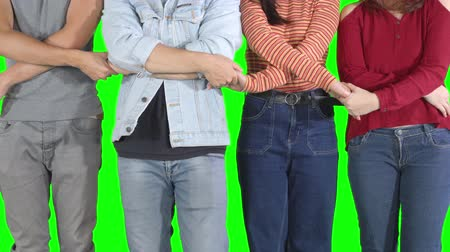 sconosciuto : Group of unknown young people holding hands each other in line showing unity or friendship symbol. Shot in 4k resolution with green screen background