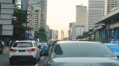busy line : JAKARTA, Indonesia - May 14, 2019: Cars moving slowly on highway in traffic jam at morning rush hour Stock Footage