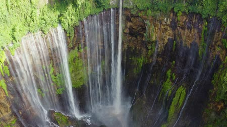 ravina : Exotic aerial landscape of Tumpak Sewu waterfall or Coban Sewu in Lumajan, East Java, Indonesia. Shot in 4k resolution from a drone flying forwards Stock Footage