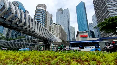 indonesia : JAKARTA, Indonesia - May 27, 2019: Futuristic pedestrian bridge with skyscrapers background in Jakarta downtown