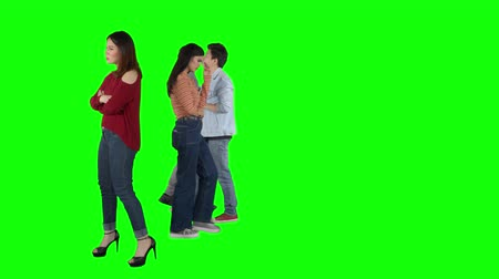 задумчивый : Group of confused young people walking back and forth while thinking in the studio. Shot in 4k resolution with green screen background