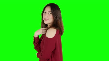 tela : Pretty young Asian female model posing in the studio. Shot in 4k resolution with green screen background Stock Footage