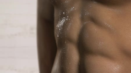 perspiration : Closeup of sweat on six pack abdominal muscle after workout at home