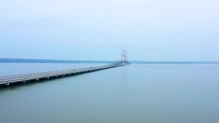 madura : Aerial view of Madura strait with Suramadu bridge on the morning in East Java, Indonesia. Shot in 4k resolution from a drone flying forwards