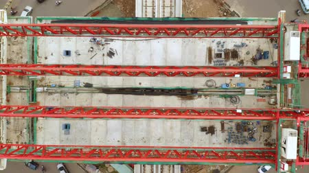 train workers : JAKARTA, Indonesia - June 26, 2019: Top down view of railroads construction for Jakarta Light Rail Transit. Shot in 4k resolution from a drone flying forwards