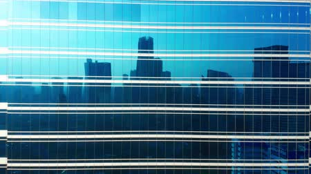 flying upwards : Aerial view of reflection on glass windows of modern skyscraper. Shot from a drone flying upwards Stock Footage