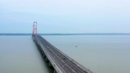 madura : Aerial scenery of Suramadu bridge with quiet traffic on the morning. Shot in 4k resolution from a drone flying forwards