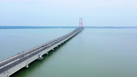 madura : Aerial landscape of Suramadu bridge on the Madura strait in East Java, Indonesia. Shot in 4k resolution from left to right