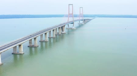 madura : Beautiful aerial landscape of Madura strait with Suramadu suspension bridge. Shot in 4k resolution from a drone flying from left to right