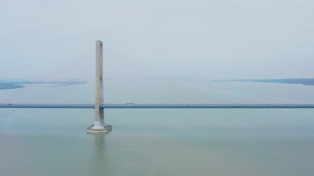 madura : Beautiful aerial scenery of Suramadu bridge on misty morning at Madura strait, East Java, Indonesia. Shot in 4k resolution from a drone flying from right to left Stock Footage