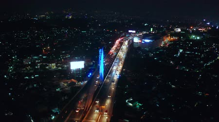 forwards : BANDUNG, Indonesia - July 03, 2019: Aerial view of night traffic on Pasupati Bridge in Bandung city, West Java. Shot in 4k resolution from a drone flying forwards Stock Footage