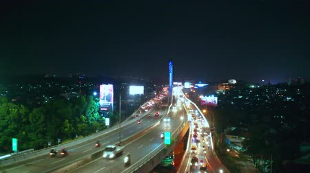 flying upwards : BANDUNG, Indonesia - July 03, 2019: Aerial landscape of night traffic on Pasupati Bridge in Bandung city, West Java. Shot in 4k resolution from a drone flying upwards